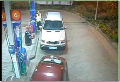 Petrol Station CCTV showing how not to cover the pumps. The image is too wide so has no detail of the number plates.